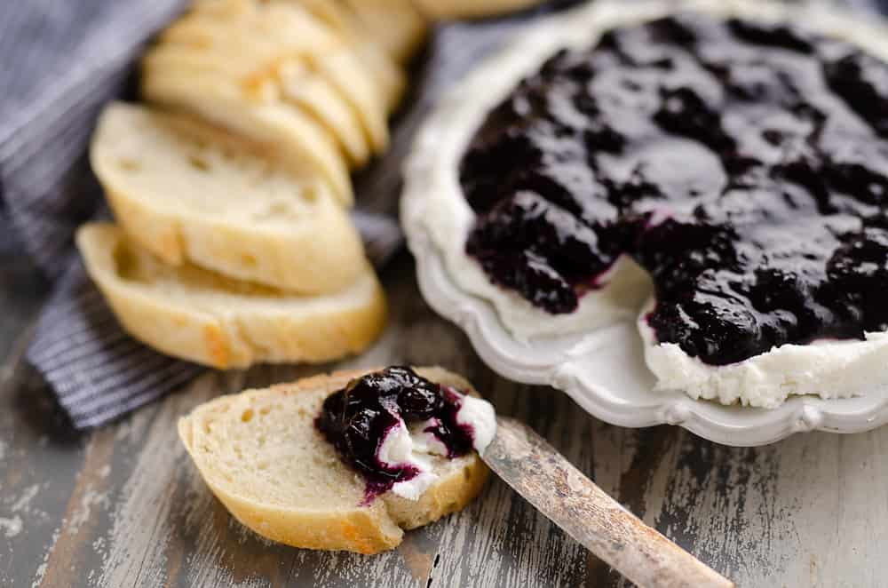 Blueberry Balsamic Goat Cheese Appetizer spread on bread with knife
