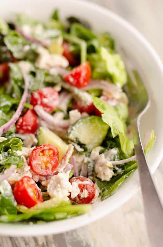 Creamy Greek Chicken Salad in a Jar tossed in bowl