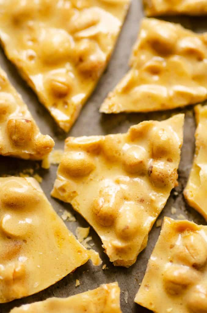 Microwave peanut brittle broken up on sheet pan