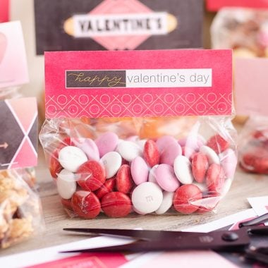 Free Printable Valentine Treat Bag Toppers filled with M&M candy