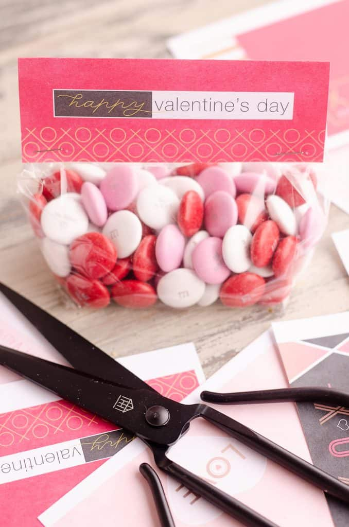 Free Printable Valentine Treat Bag Toppers assembled and filled with candy