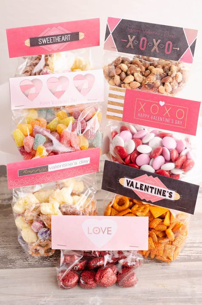 Free Printable Valentine Treat Bag Toppers in a variety of designs filled with candy and healthy snacks