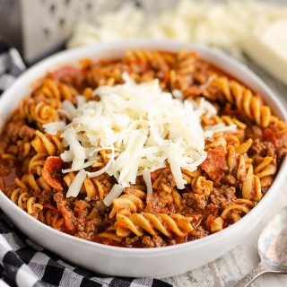 Pressure Cooker Light Pizza Noodle Casserole served with shredded cheese