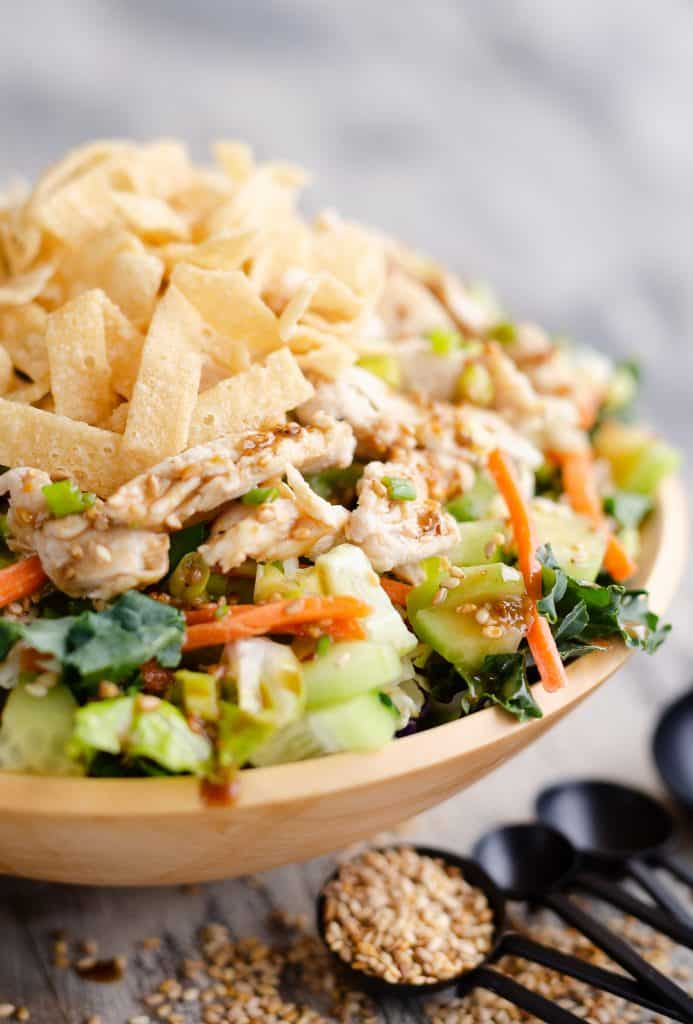 Asian Toasted Sesame Chicken Salad in homemade wooden bowl