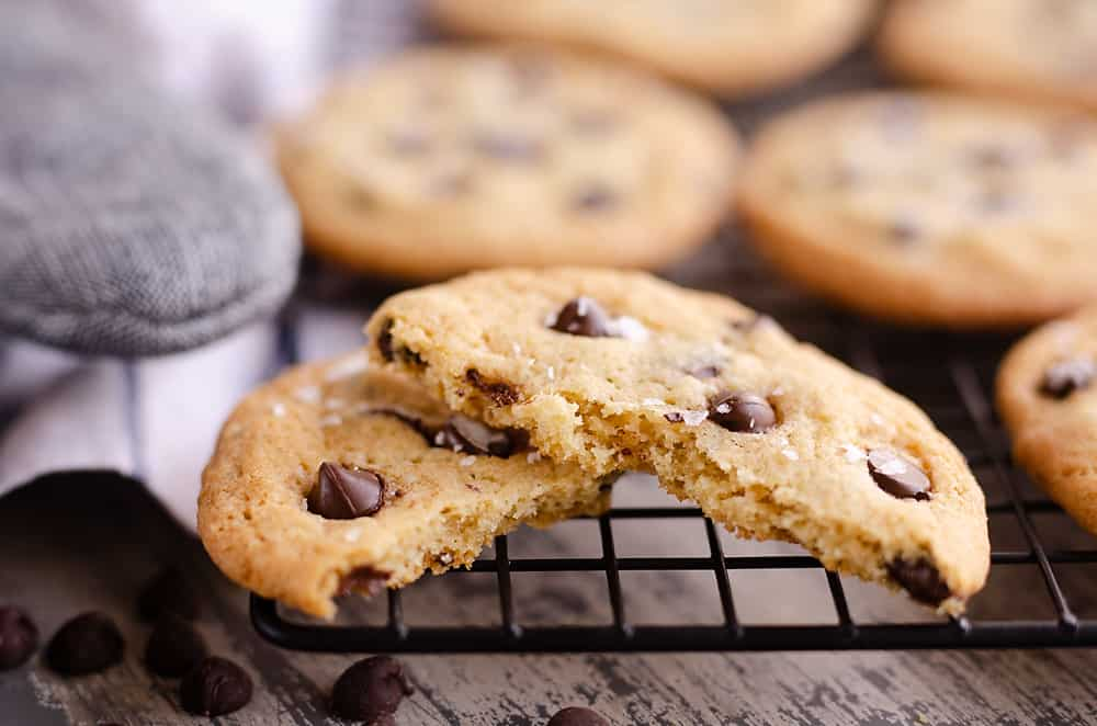 Best Chewy Chocolate Chip Cookie Recipe split in half on cooling rack