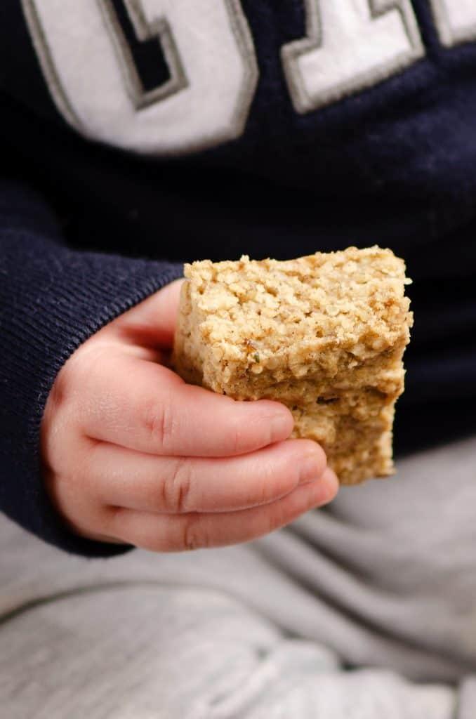 child holding Kids No Sugar Peanut Butter Banana Oatmeal Bars