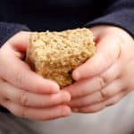 Toddler holding Kids No Sugar Peanut Butter Banana Oatmeal Bars