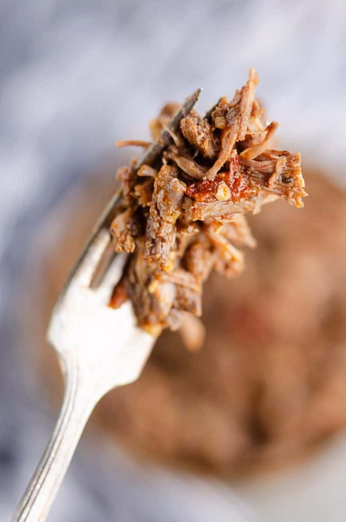 Chipotle Garlic Pressure Cooker Shredded Beef bite on fork