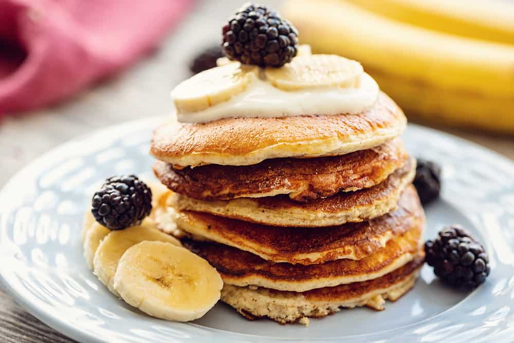 Light & Fluffy Banana Protein Pancakes on plate