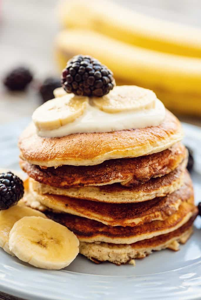 Light & Fluffy Banana Protein Pancakes stack with fruit