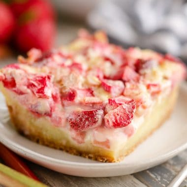 Strawberry Rhubarb Custard Dessert slice on plate
