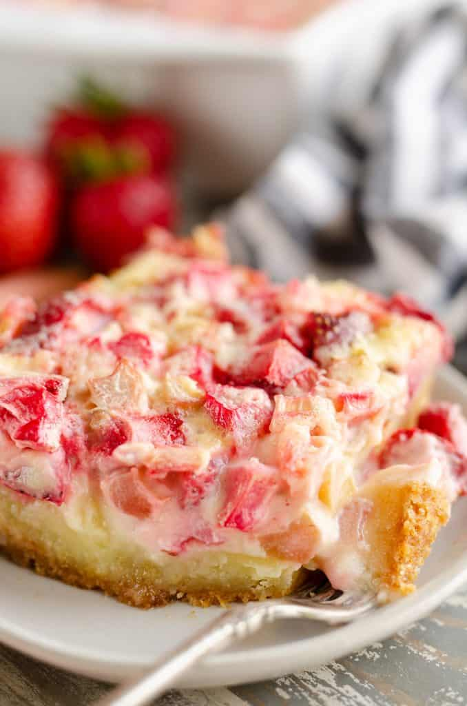 Strawberry Rhubarb Custard Dessert slice with bite on fork