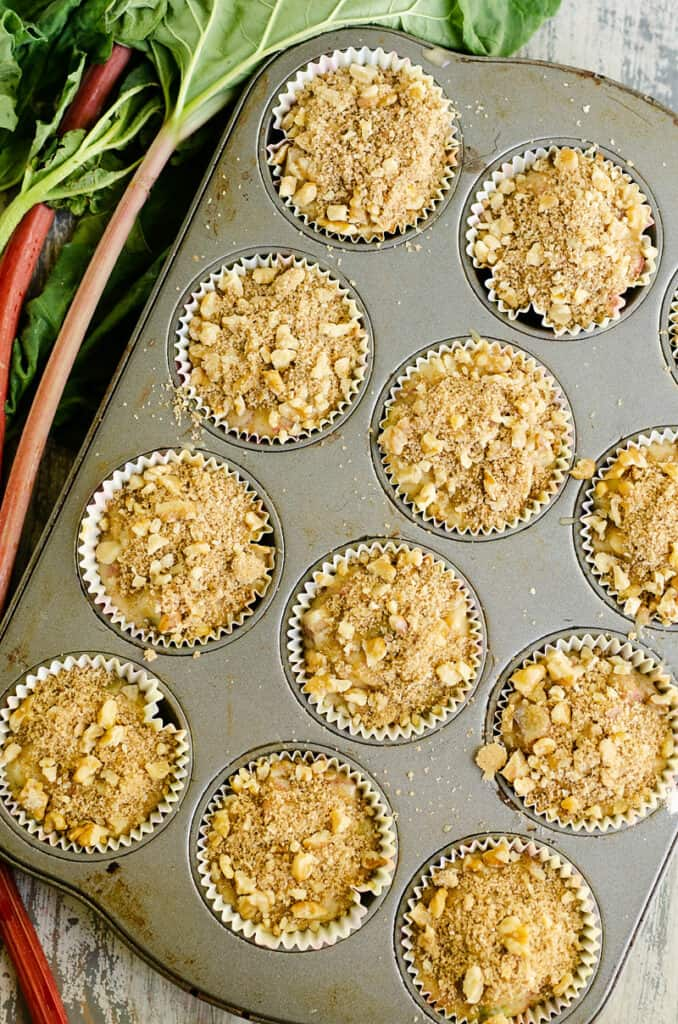 rhubarb muffins in muffin tin topped with walnut streusel