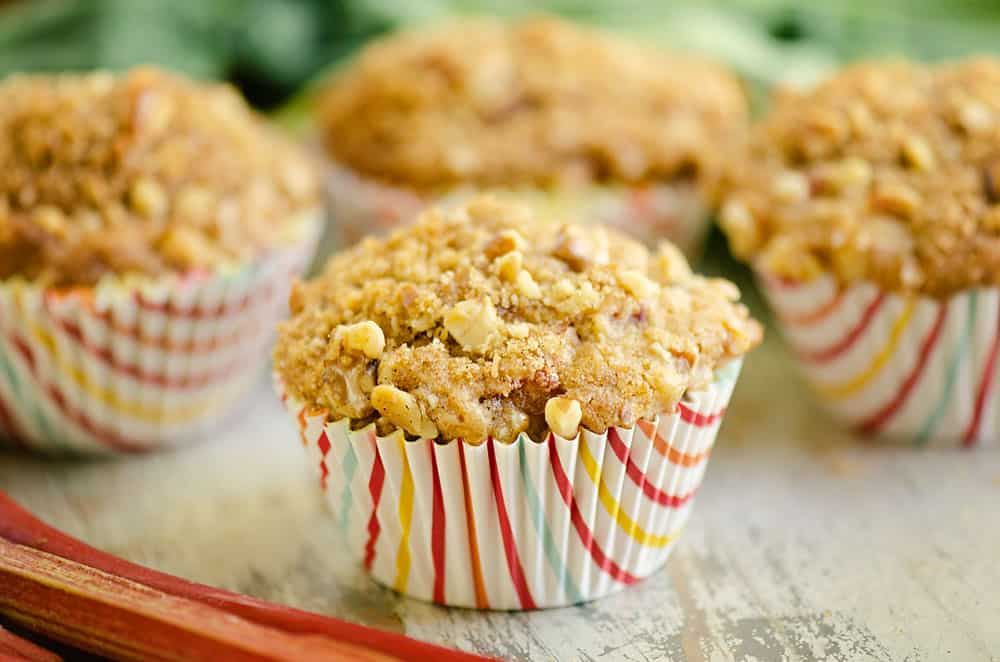 rhubarb muffins topped with brown sugar and walnut streusel on table