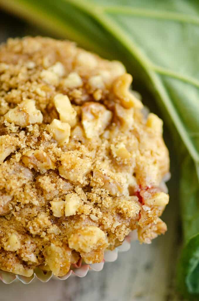 walnut and brown sugar streusel on the top of a rhubarb muffin