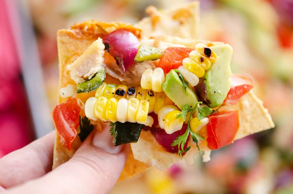 Avocado Corn Chicken Nachos chip full of toppings