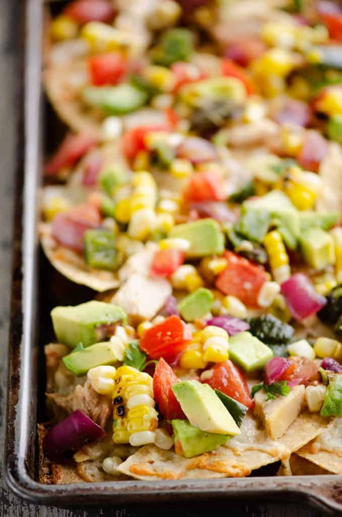 Avocado Corn Chicken Nachos on sheet pan