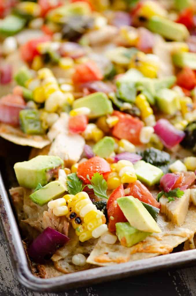 Avocado Corn Chicken Nachos cooked on sheet pan