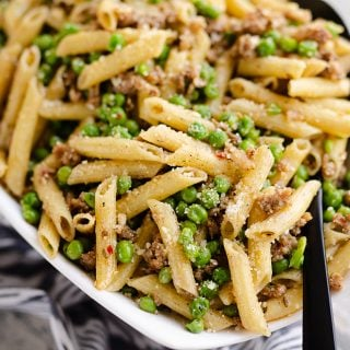 Brown Butter Sausage Penne Pasta served with large spoon