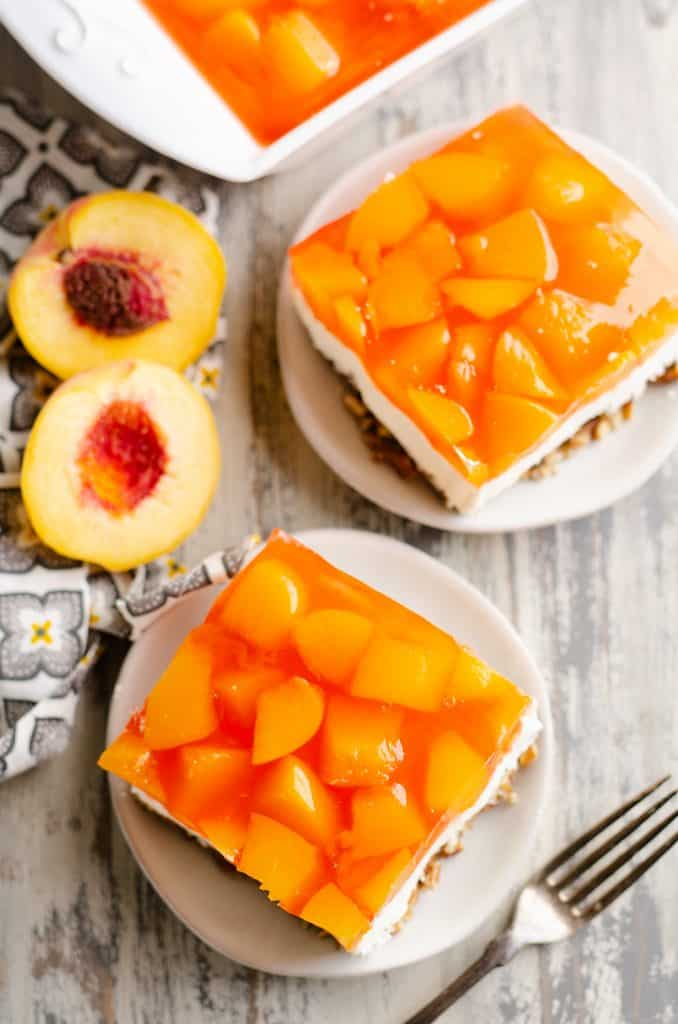 Peach Pretzel Salad Dessert slices served up on table