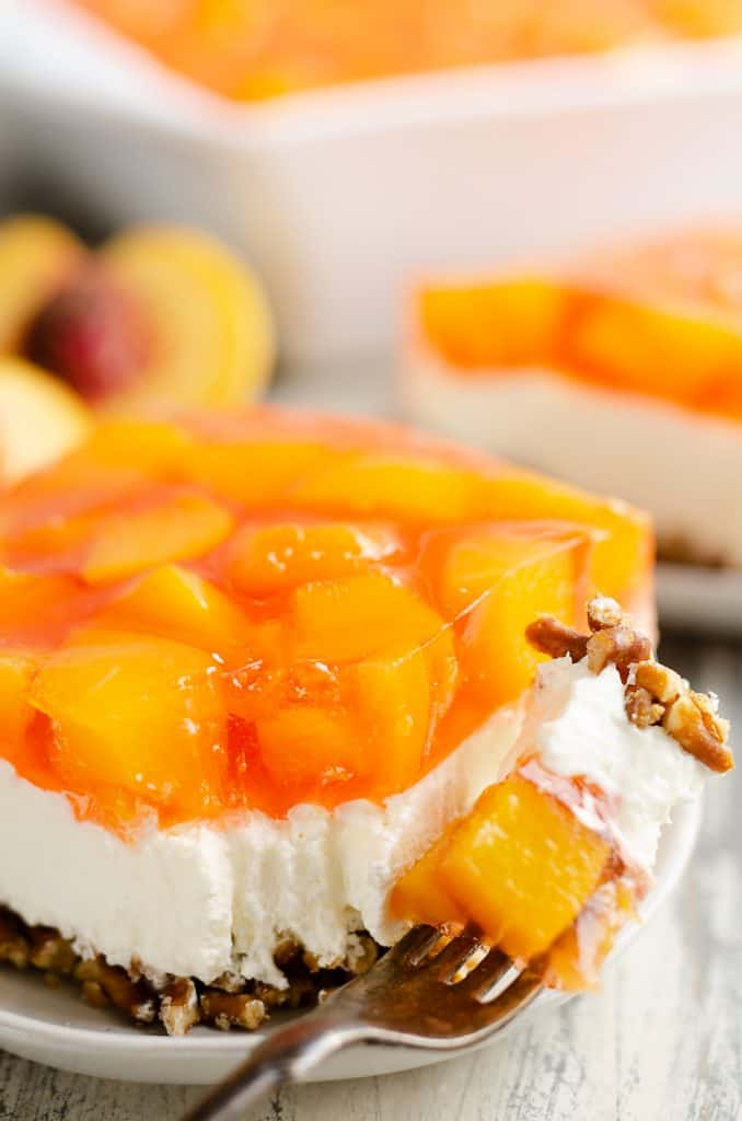 Peach Pretzel Salad Dessert with bite taken out of piece