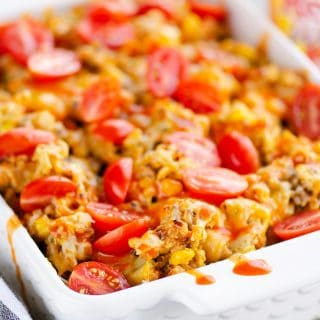 Pressure Cooker Buffalo Chicken Quinoa in casserole drizzled with sauce