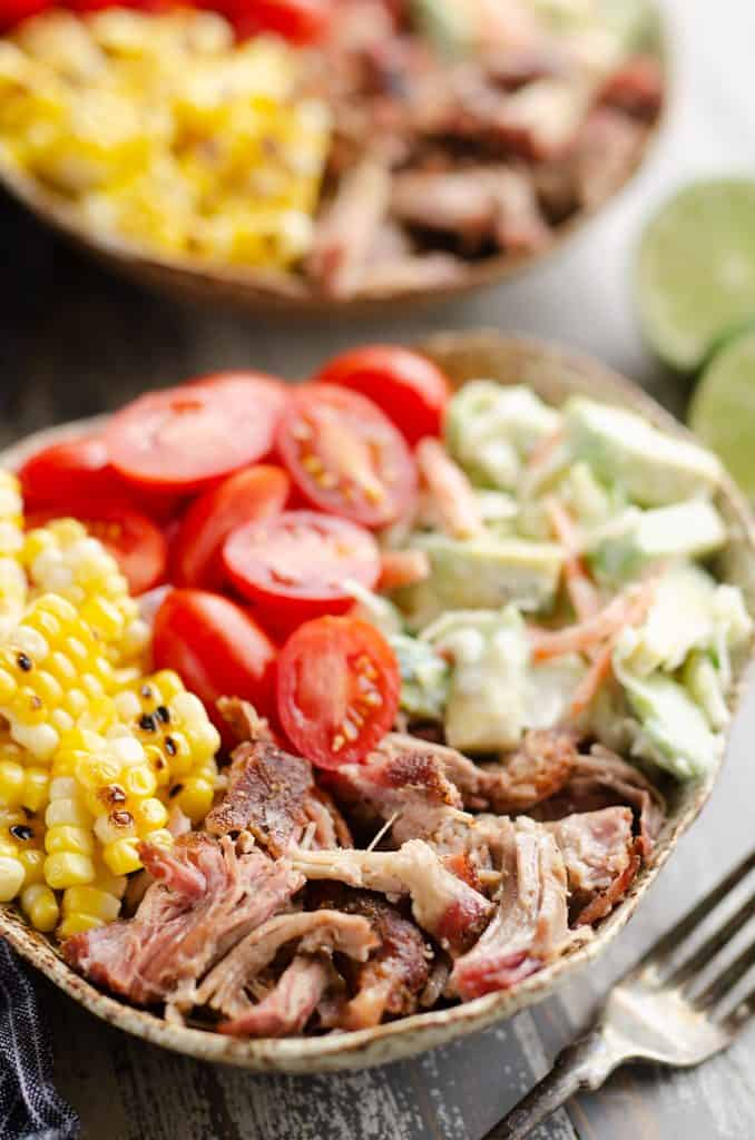 Pulled Pork Bowls with Avocado Slaw served on table