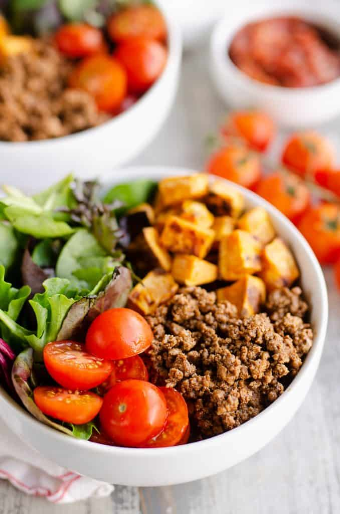 Sweet Potato Taco Bowls with cherry tomatoes