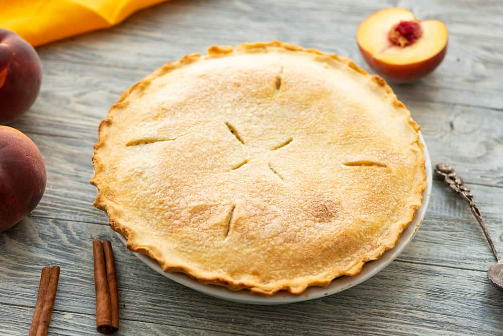 Homemade Peach Pie in pie tin