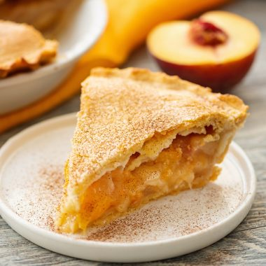 Homemade Peach Pie slice served on plate