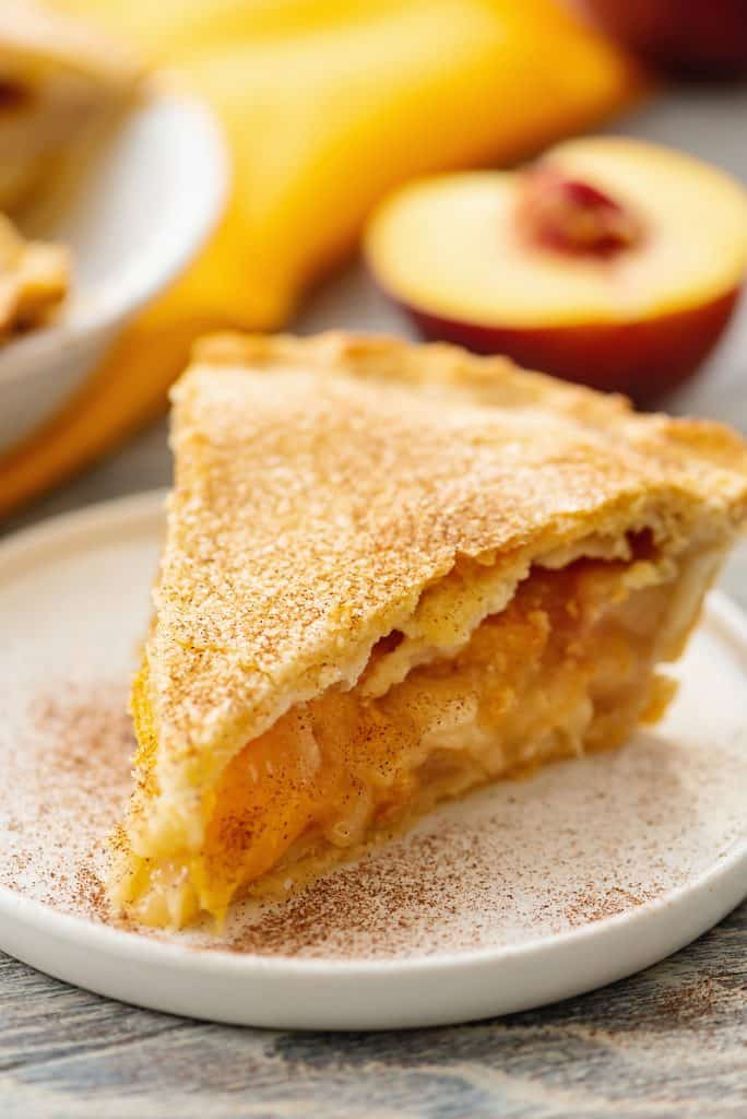 Homemade Peach Pie slice on plate