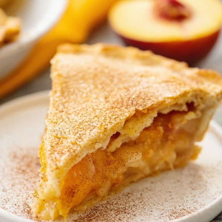 Homemade Peach Pie slice on plate