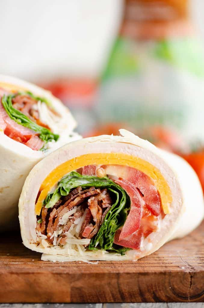 Turkey Bacon Parmesan Ranch Wrap sliced on cutting board