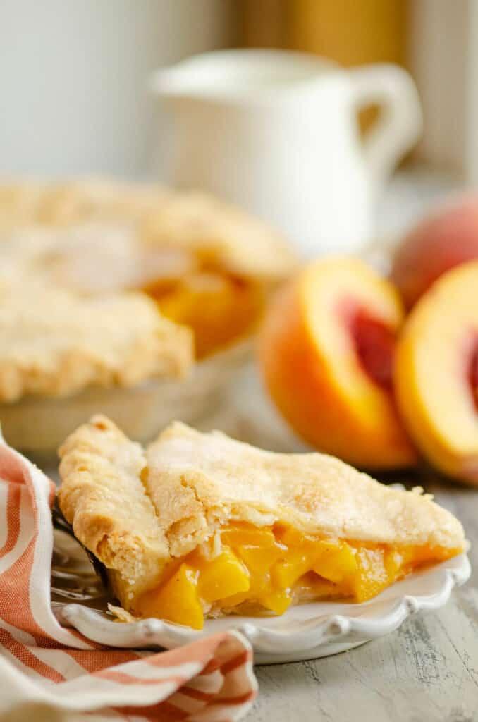 slice of peach pie on plate on table