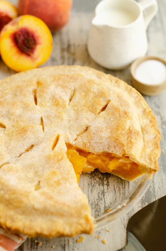 peach pie with slice removed