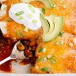 Black Bean & Squash Vegetarian Enchiladas scooped out of serving dish