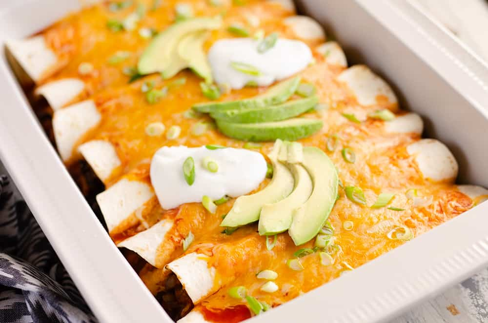 Black Bean & Squash Vegetarian Enchiladas served on dinner table