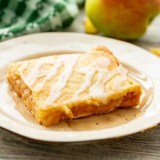 Glazed Apple Pie Bars square piece on plate