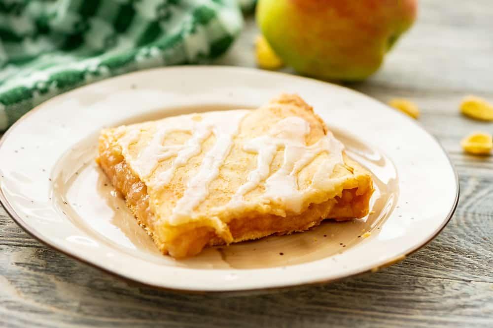 Glazed Apple Pie Bars square piece on plate