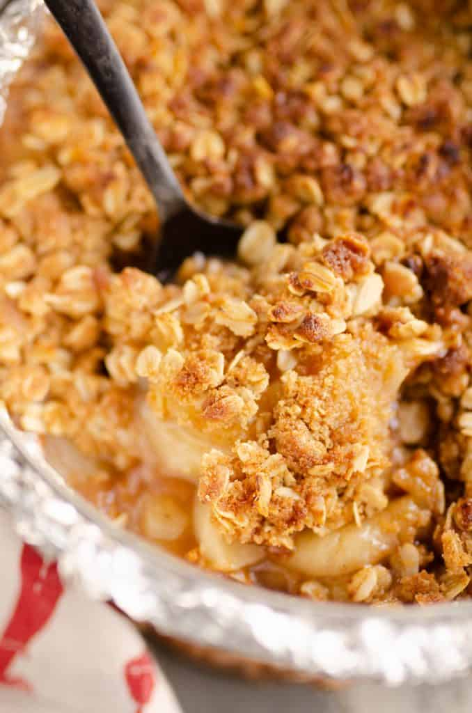 Crispy Pressure Cooker Apple Crisp being scooped from pan