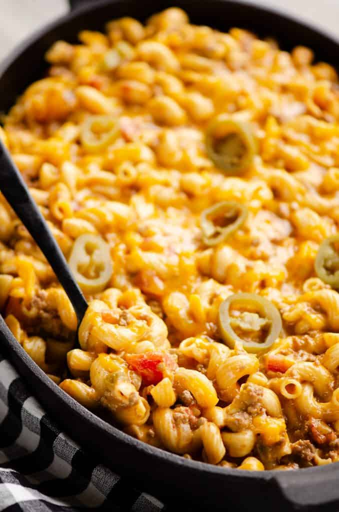Pressure Cooker Taco Mac and Cheese with spoon in skillet