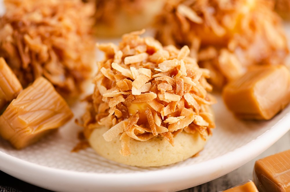 sugar cookie topped with caramel and toasted coconut