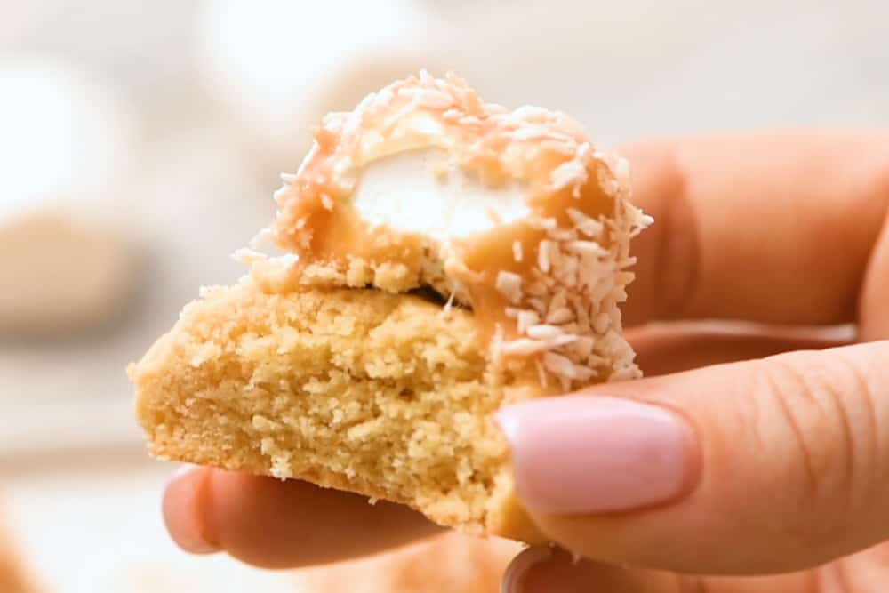 toasted coconut marshmallow cookie with bite taken