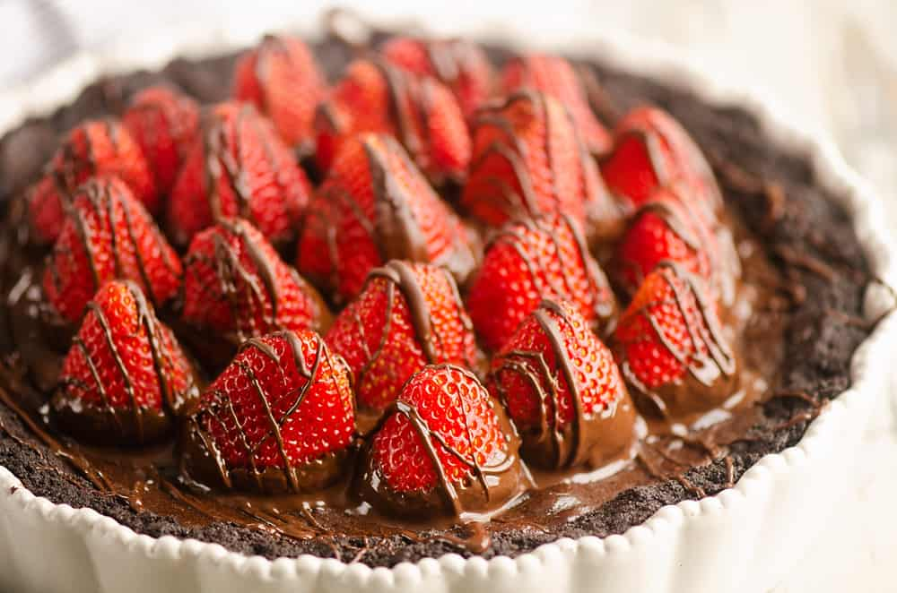 Chocolate Covered Strawberry Ganache Tart on table