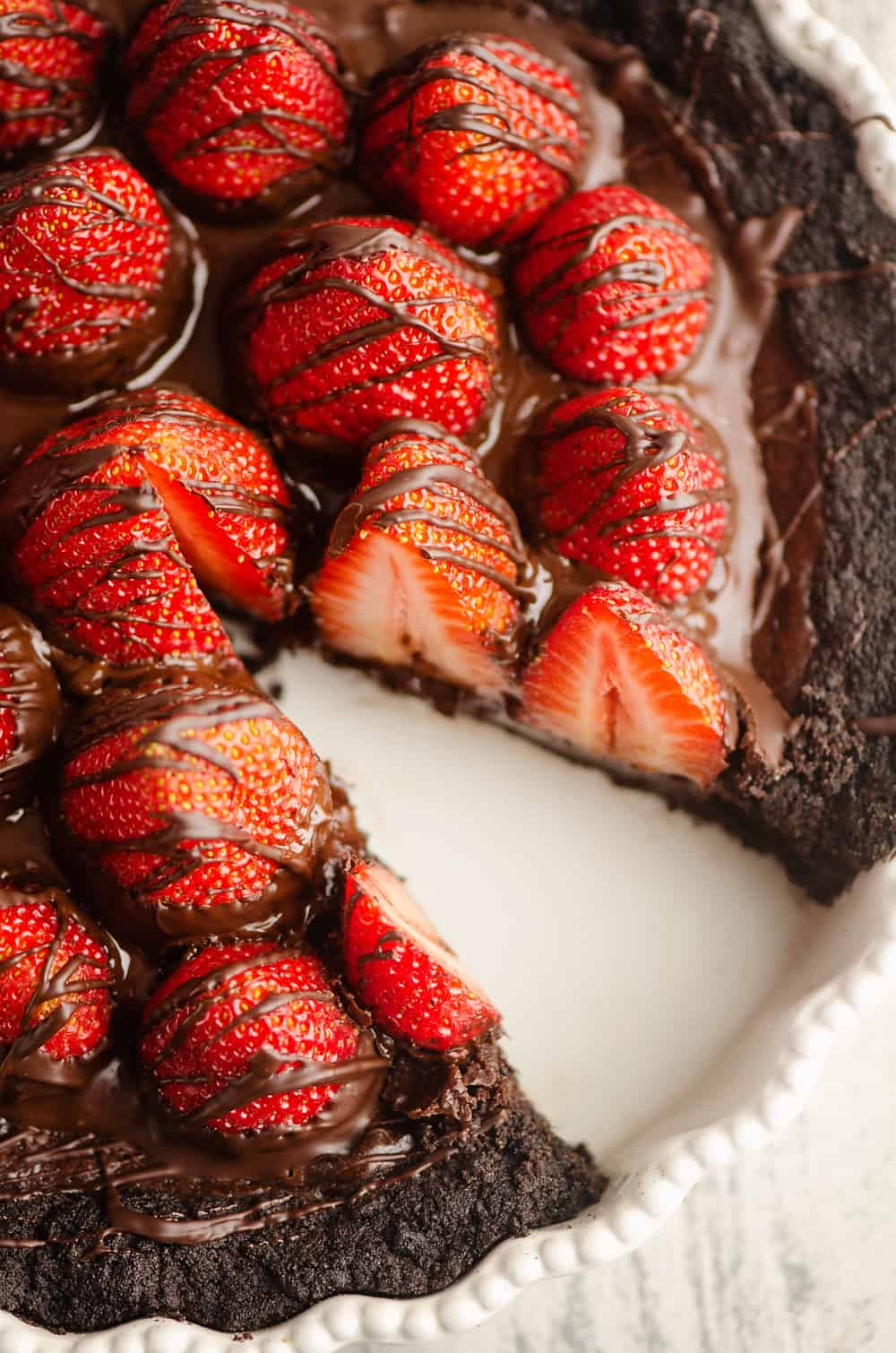 Chocolate Covered Strawberry Ganache Tart with slice removed