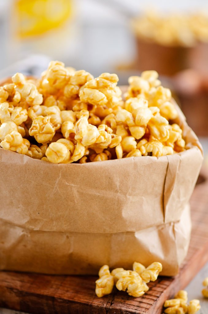 Microwave Caramel Popcorn in a brown paper bag on a table