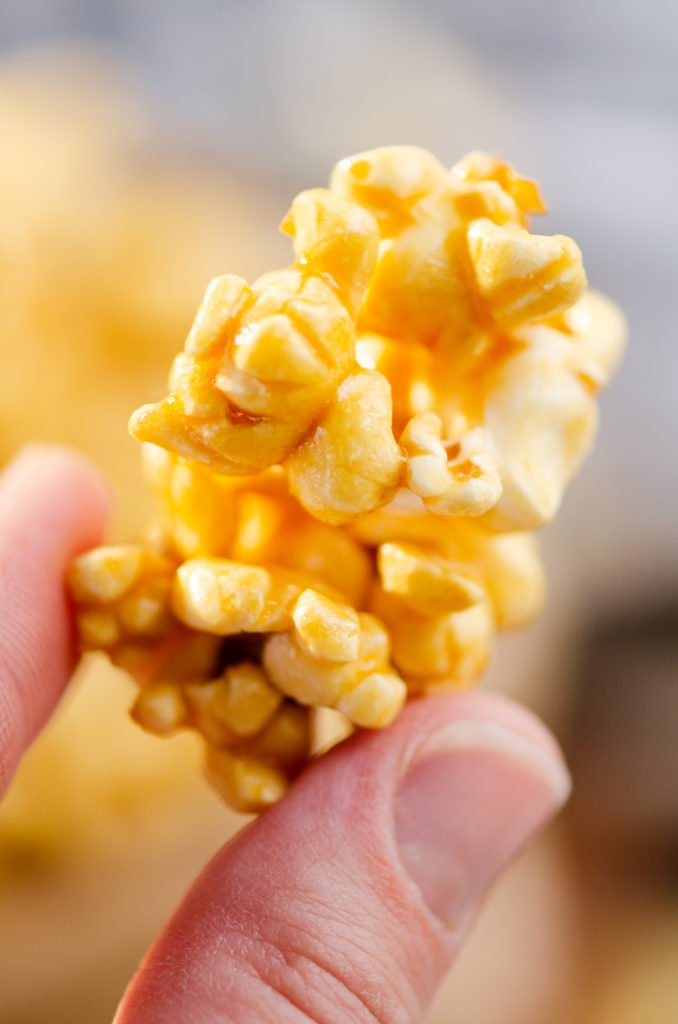 cluster of microwave Caramel Popcorn held in hands