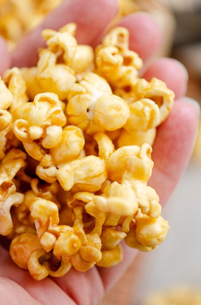 Microwave Caramel Popcorn in hand