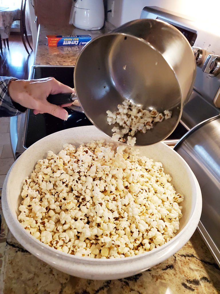 stovetop popcorn being poured from kettle into bowl