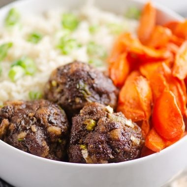 Glazed Hoisin Meatballs, carrots and rice in white bowl